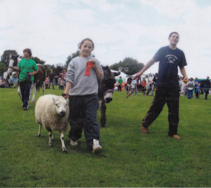 Sarah showing sheep, winner of Most Obedient Animal